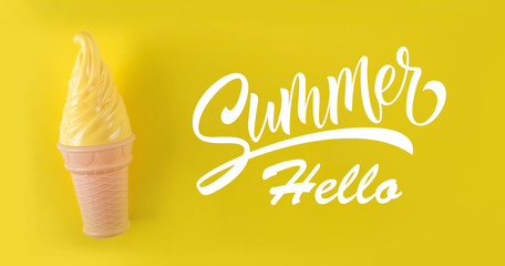 Yellow ice cream on a yellow background. Text hello summer