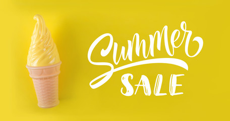 Yellow ice cream on a yellow background. Summer sale text.