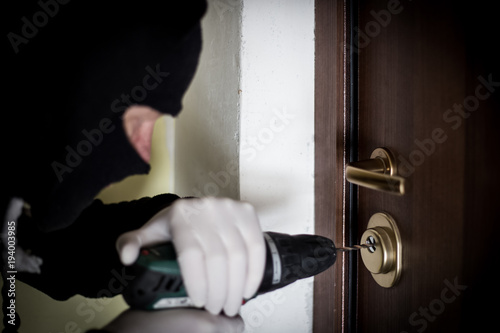 Crime Robbery Masked Thief Burglar Trying To Break Into A Flat