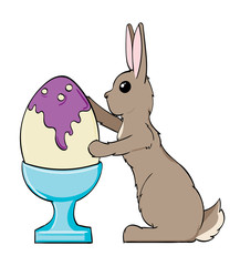 Bunny painting an Easter egg in an egg cup