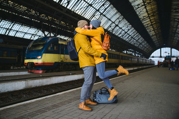 happy couple at railway station. meet after long time no see eac