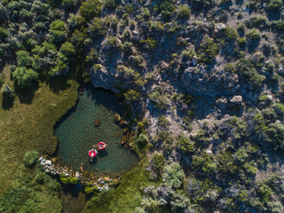 Overhead view of couple floating on inflatable rings in lake
