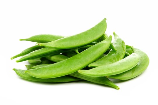 Pile of fresh snap peas. Side view isolated on a white background.