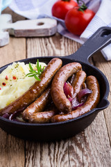 Sausage and onion casserole with potato mash