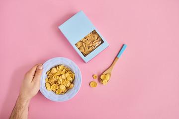 Cereals on pink background