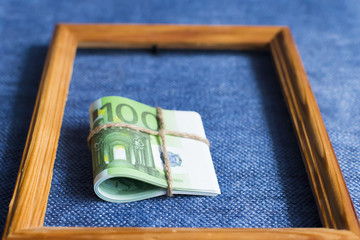 eurocurrency in the frame on blue background