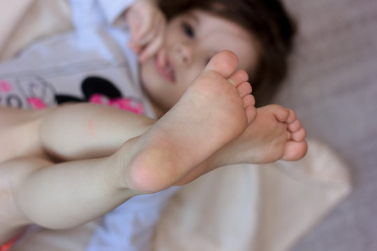 Kids toes and heels. Baby shows foots.