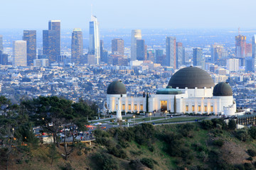 Griffith Observatory Park with Los Angeles Skyline at Dusk. Twilight views of the famous monument and downtown from Santa Monica Eastern Mountains. Los Angeles, California, USA.