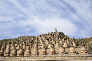 The One Hundred and Eight Stupas is an array of one hundred and eight Buddhist stupas on a hillside on the west bank of the Yellow River at Qingtongxia in Ningxia, China.