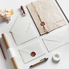 Vintage still life with postal accessories. Blank stationery and envelopes on paper background. Responsive design mockup.