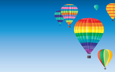 Hot air balloons flying on clearly blue sky background. Available for tour text. Festival, holiday, explore, travel, journey concept.