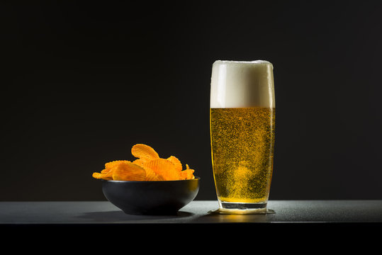 bowl of chips on dark background
