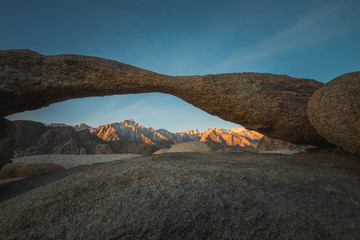 Lathe Arch and the Glowing Lone Pine Peak with the Sierra Nevada Mountains During Sunrise in Alabama Hills, Lone Pine, California
