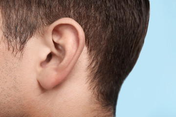 Young man, closeup of ear. Hearing problem