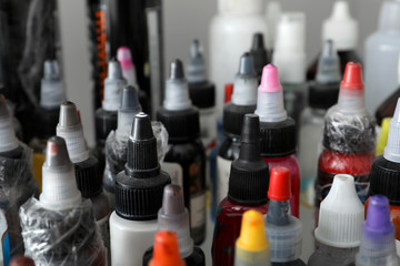 Many bottles with ink in tattoo salon