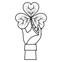 dotted shape hand man with clover plant and leaves