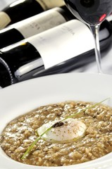 Risotto with three funghi with egg poche and black truffle