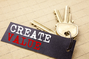 Conceptual hand writing text caption showing Create Value. Business concept for Creating Motivation written on note paper attached to the keys note paper on the texture background.