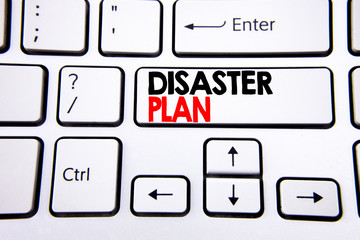 Hand writing text caption inspiration showing Disaster Plan. Business concept for Emergency Recovery written on white keyboard key with copy space. Top view.