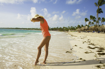 girl walking on sand beach by the Ocean Dominican republic Vacation travel concept