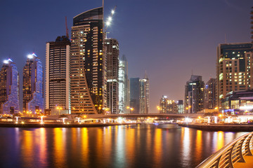 DUBAI, UAE - FEBRUARY 2018: Colorful evening on canal and promenade in Dubai Marina,Dubai,United Arab Emirates