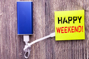 Handwriting Announcement text showing Heppy Weekend . Business concept for Weekend Message written on sticky note with copy space on old wood wooden background with power bank