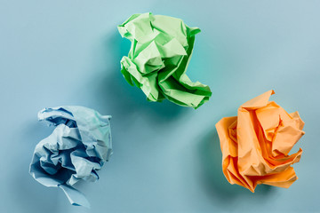 Crumpled multi colored paper, with soft texture, paper ball.