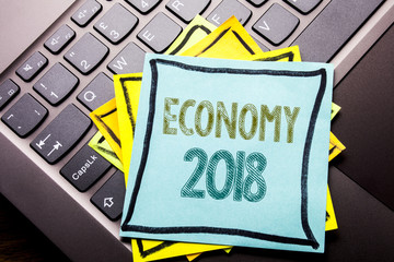 Conceptual hand writing text caption inspiration showing Economy 2018. Business concept for Word  finance Future Plan written on sticky note paper on the dark keyboard background.