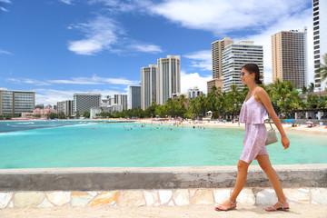 Wall Mural - Waikiki beach Honolulu Hawaii tourist woman on summer travel vacation walking in city. Skyline background landscape.