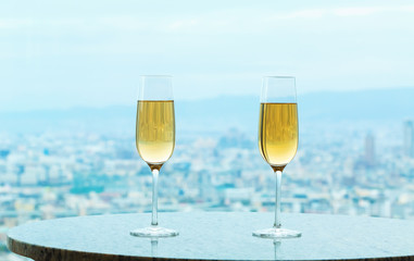 White wine on a table high above the city