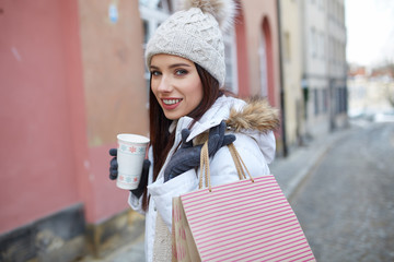 pretty young woman with shopping bags in the city