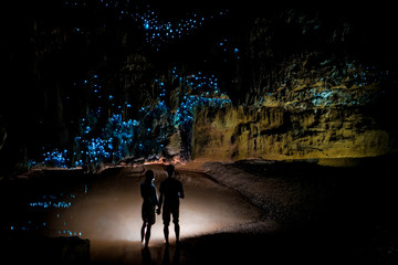 Couple under New Zealand Glow Worm Sky in Waipu Cave