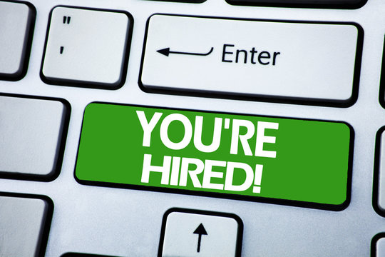 Handwriting Announcement text showing You Are Hired. Business concept for Hiring Employee Worker written on blue key on the keybord background.