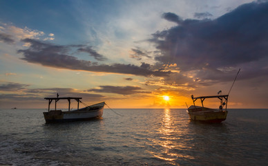 Fishing Boats and Golden Sunset over the Sea