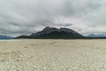 Mud cracked by the coast of Abraham Lake, Clearwater County, Alberta, Canada