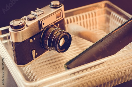 Old photo camera and objects for developing photos