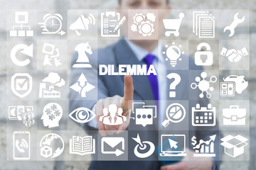 Businessman pressing dilemma text button on a virtual interface. Business dilemmas. Business development concept for lost, confusion, directions or  decisions.