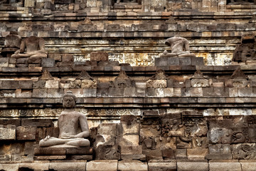 Fragment of the Borobudur Temple. Ancient stone statue of Buddha. Indonesia. Java island.