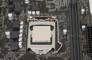 Close up of installed CPU processor on modern, new motherboard