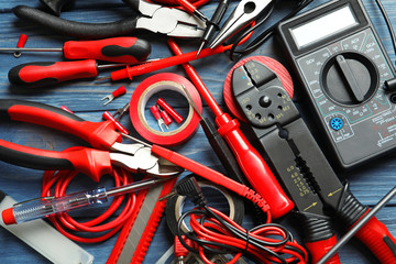 Different electrical tools on table