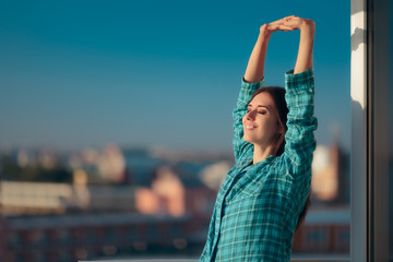 Girl in Pajamas Waking up Early and Stretching in Morning Light