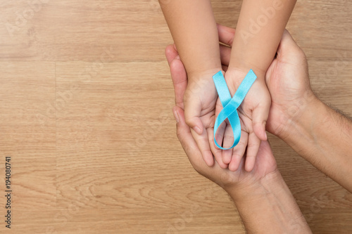 Mens Health Care Concept Father And Son Hands Holding