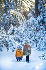 The kids in the winter woods.