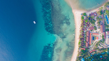 Aerial view from the drone on the sand beach of Haad Rin, Koh Phangan island, Thailand