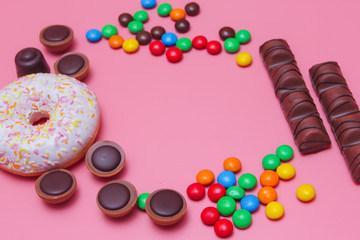 a lot of sweets on a pink background. Candy background. colorful candy and sweets.