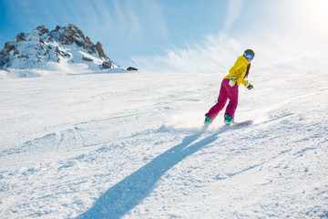 Image of sports woman snowboarding on snowy slope