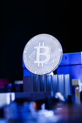 Picture of coin bitcoin and processor on blue background
