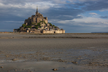 Dramatic view of the majestic Mont Saint Michel abbey at low tide in Normandy, France