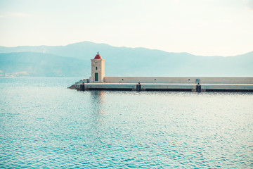 Light-house in the beautiful harbor of a small town Postira - Croatia, island Brac