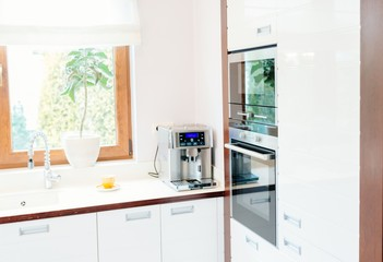 Modern house kitchen with white wooden furnitures
